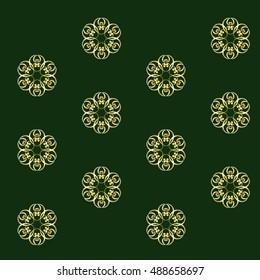 Metallic gold ribbon ornament on dark green ground