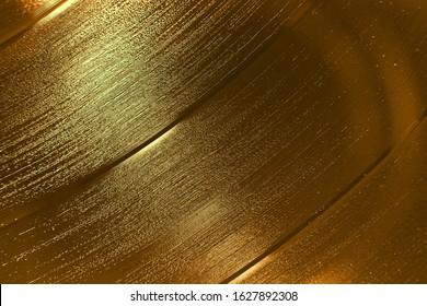 Metallic gold shiny vinyl record background texture