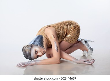 Metallic gold silver fashion girl with silver makeup on white background