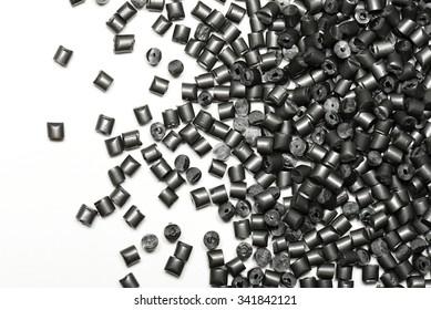 metallic gray polymer on white background in lab