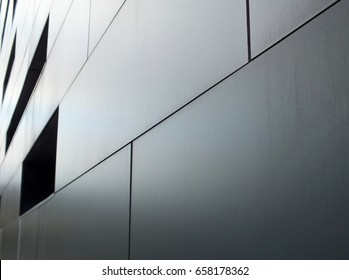 metallic grey cladding on modern industrial building