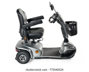 Metallic grey three wheel mobility scooter with front basket on white background.