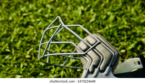 Metallic grills of a cricket helmet isolated object photo