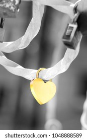 A metallic heart shaped love padlock isolated on black and white background. Clipping path available