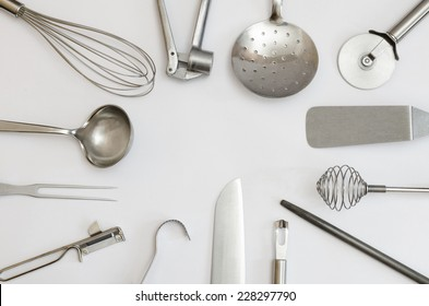 metallic kitchen utensils and tools building a frame