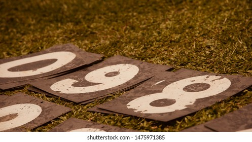 Metallic number plates fallen on a ground unique photo