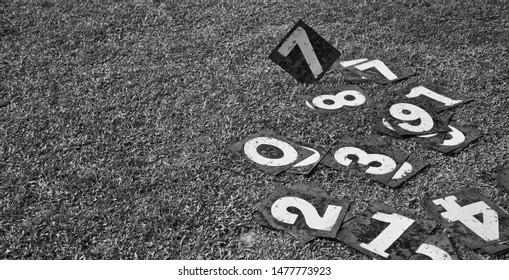 Metallic number plates on a ground isolated unique photo