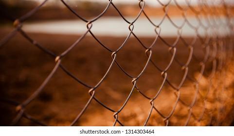 A metallic parts of a protection fence unique photo