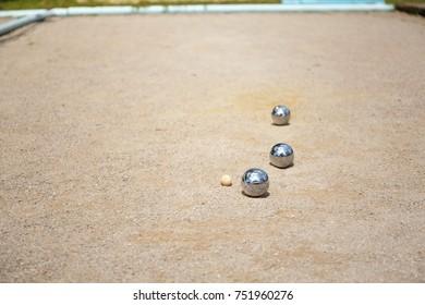 Metallic petanque three balls and a small wood jack