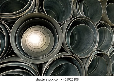 Metallic Pipes stacked in rows pattern
