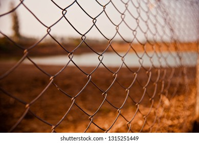 A metallic protection fence isolated object photo