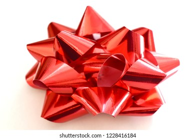 Metallic red ribbon gift bow isolated