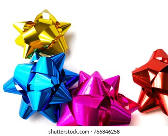 Metallic ribbons on white isolated background.