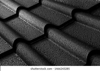Metallic roof with drops of water.