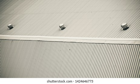 A metallic rooftop of a factory building black and white photo