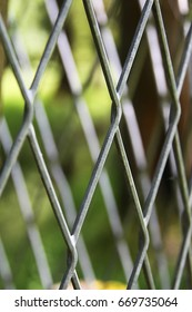 Metallic seamless fence and the green nature on the background