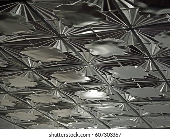 Metallic silver ceiling tiles with an art deco pattern