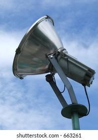 Metallic spotlight close up with sky background