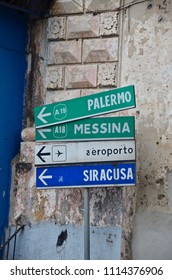 Metallic street sign to Palermo Messina Syrakusa in Sicily