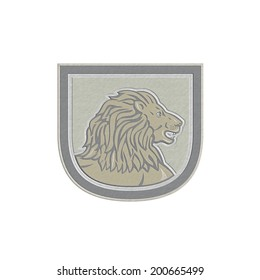 Metallic styled illustration of an lion big cat head viewed from side set inside shield crest on isolated background done in retro style.