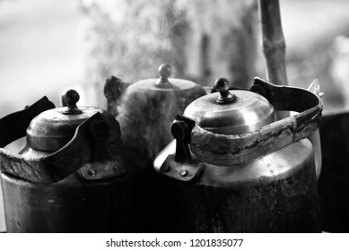 Metallic tea kettles isolated object unique photo