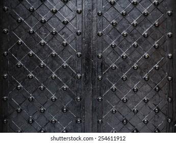 metallic texture black elements of the old door.