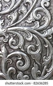 metallic texture embossed into an ancient doorway