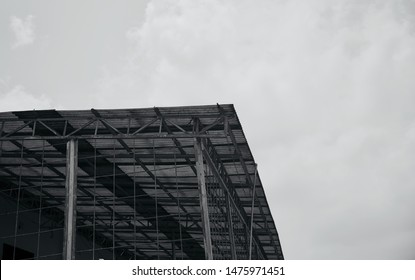 Metallic tin shed roof of a building black and white photo