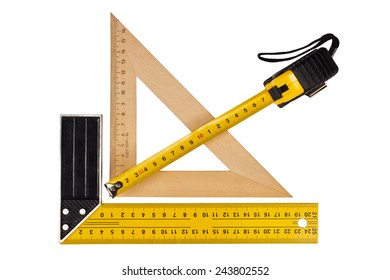 Metallic tool to measure right angle, triangle and wooden ruler, pencil and tape measure on a white background