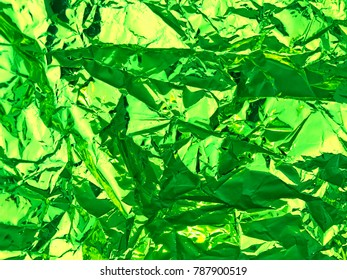 Metallic wrinkled abstract grunge green background.