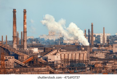 Metallurgical plant. Industrial landscape. Steel factory at sunset. Pipes with smoke. steelworks, iron works. Heavy industry in Europe. Air pollution from smokestacks, ecology problems. Vintage