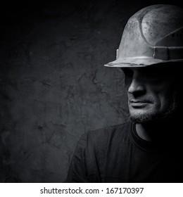 metallurgist portrait on dark background