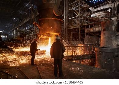 Metallurgists at casting ingots