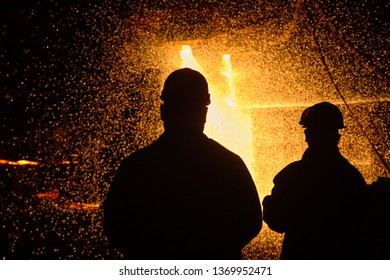 Metallurgists at casting ingots in Foundry Shop, Metallurgical production