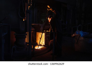 Metallurgists at casting ingots in Foundry Shop