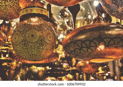 Metalwork lampshades hanging outside a shop in a Marrakesh souk