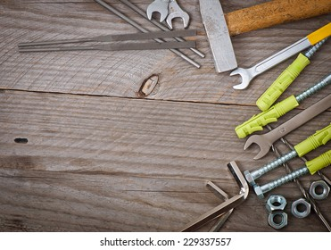 metalwork tools on the old wooden background