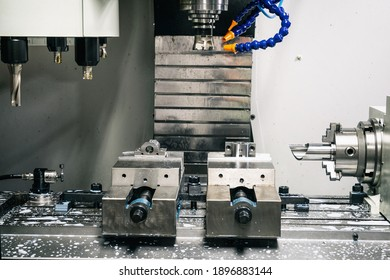 Metalworking CNC lathe milling machine with coolant. Milling  apiece of aluminium. Industrial metalworking cutting process on cnc machine.