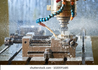 Metalworking CNC milling machine. Cutting metal modern processing technology.Milling metalworking process. Industrial high precision CNC metal machining by vertical mill.