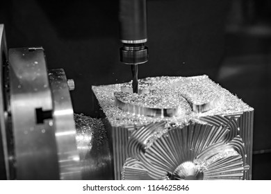 Metalworking CNC milling machine. Cutting metal modern processing technology. Small depth of field. Warning - authentic shooting in challenging conditions.