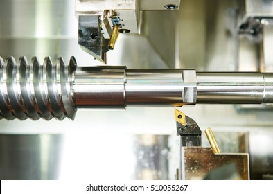 metalworking machining industry. cutting tool processing steel metal spiral pinion or worm screw shaft on lathe machine in workshop. Focus on tool.