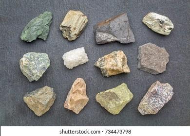 metamorphic rock geology set, from top left: chlorite schist, garnet schist, graphite schist, mica schist, serpentinite, marble, gneiss, slate, amphibolite, dolomitic marble, epidosite, quartzite