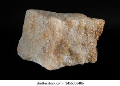 Metamorphic rock sample - quartzite, isolated on black background, macro frame