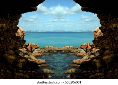 metaphor of the maternal womb, allegory of protection, welfare, peace, tranquility,Cavern in Formentera island, Spain, Symmetrical photographs of landscapes of balearic islands, visual allegories,