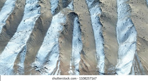 Metaphor of vinyl record under the microscope, tribute to Pollock, abstract photography of the deserts of Africa from the air, aerial view, abstract expressionism, contemporary photographic art,