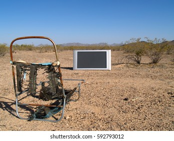 A metaphoric image using a broken Plasma TV and a decaying lawn chair in the Arizona desert to symbolize the wasteland that is commercial Television.