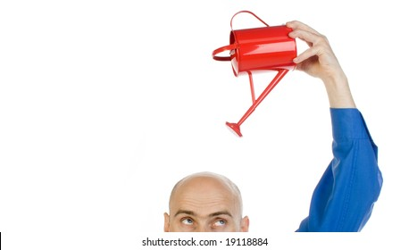 A metaphorical image of a bald man in a blue shirt, pouring a red water can on his head to improve his intelligence, on a white background.