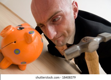 A metaphorical image of a crazy businessman breaking his piggybank to buy a new house from his savings.