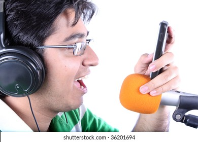 A metaphorical image of a singer recording a ringtone / dialler-tone for a record company in music studio, on white studio background.