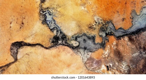 metastasis, allegory,black gold,polluted desert sand,tribute to Pollock, abstract photography of the deserts of Africa from the air, aerial view, abstract expressionism, contemporary photographic art